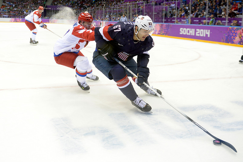 . Max Pacioretty (67) of the U.S.A. controls the puck as Alexei Tereshenko (27) of the Russia defends  during the first period of men\'s hockey action at Bolshoy arena. Sochi 2014 Winter Olympics on Saturday, February 15, 2014. (Photo by AAron Ontiveroz/The Denver Post)