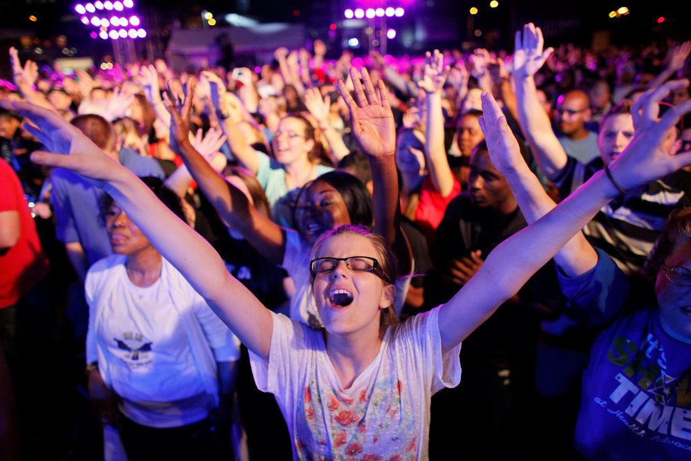 Description of . In this Friday, Sept. 28, 2012 file photo, Dharma Bohall, 13, raises her arms in prayer during the America for Jesus prayer rally on Independence Mall in Philadelphia. Christian conservatives who blame