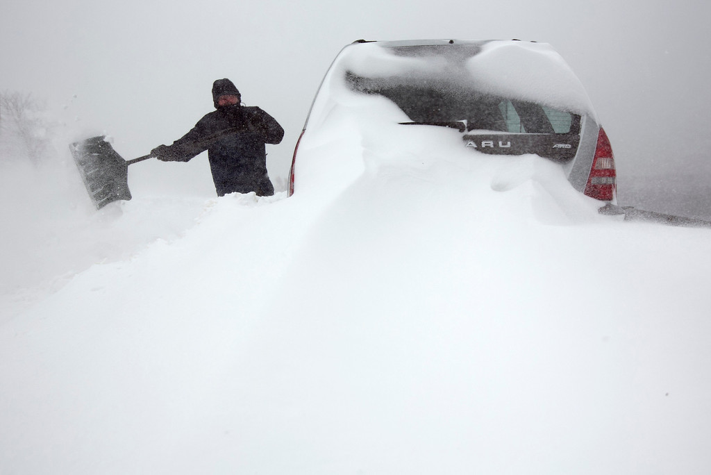. Steve Hull digs out his car after it was covered by drifting snow in Portland, Maine on Saturday, Feb. 9, 2013. A behemoth storm packing hurricane-force wind gusts and blizzard conditions swept through the Northeast overnight. (AP Photo/Robert F. Bukaty)