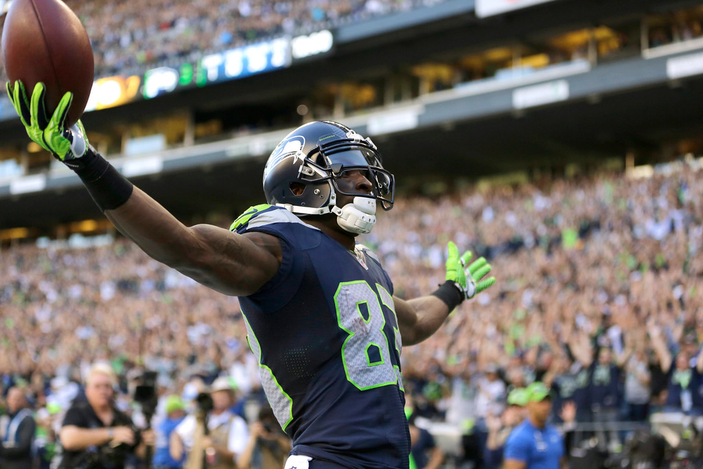 . Seattle Seahawks wide receiver Ricardo Lockette celebrates after his touchdown against the Green Bay Packers in the first half of an NFL football game, Thursday, Sept. 4, 2014, in Seattle. (AP Photo/Scott Eklund)