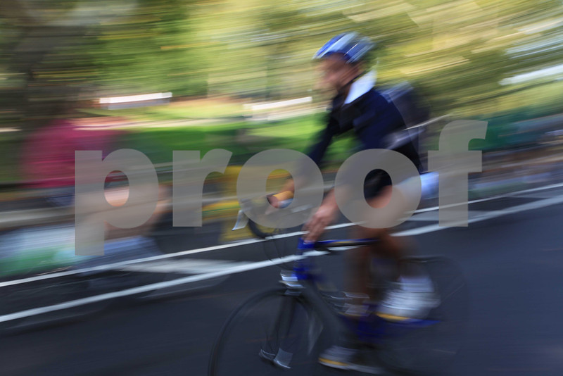 A cyclist glides through Central Park in new York City.