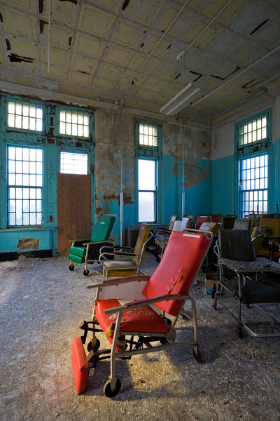 Room full of geriatric chairs near day's end, Buffalo State Hospital.