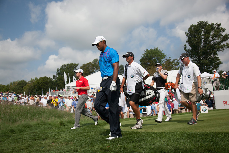 Tiger Woods walks off the 10th tee during first round action at the BMW Championship at Crooked Stick CC in Carmel Indiana on Thursday Sept. 6, 2012. (Charles Cherney/WGA)