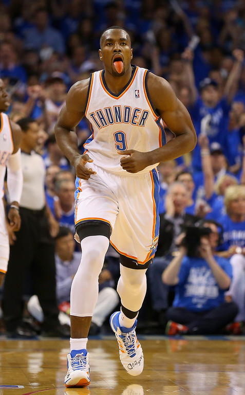 . Serge Ibaka #9 of the Oklahoma City Thunder reacts after a basket in the first quarter against the San Antonio Spurs during Game Three of the Western Conference Finals of the 2014 NBA Playoffs at Chesapeake Energy Arena on May 25, 2014 in Oklahoma City, Oklahoma.  (Photo by Ronald Martinez/Getty Images)