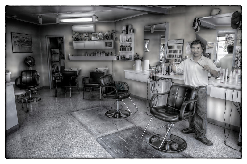 I guess everyone goes through phases when they are learning photography. I am in my cartoon HDR phase.  I went to get my haircut today and I took a picture of my Barber, Sun.  He is a real cool guy, immigrated to San Diego with his family from Vietnam and now supports everyone by cutting hair.  He has been doing it for 20 years and is the best in La Jolla.