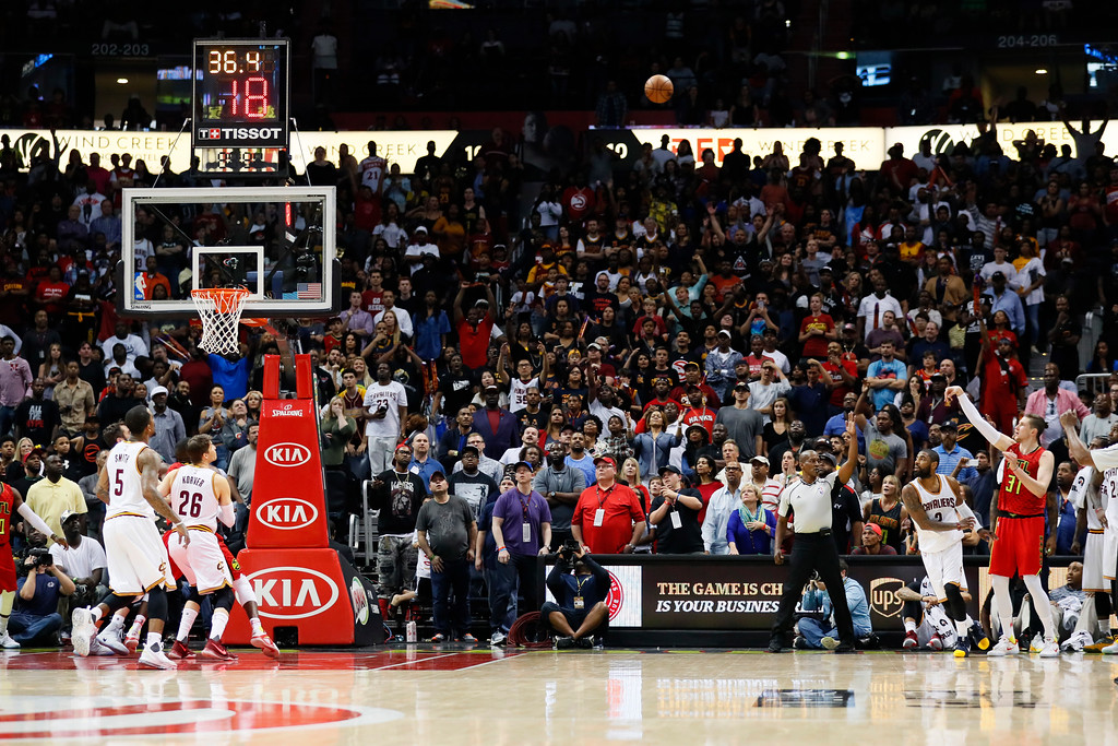 . Atlanta Hawks forward Mike Muscala (31) shoots a 3-pointer to take the lead in overtime of an NBA basketball game against the Cleveland Cavaliers, Sunday, April 9, 2017, in Atlanta. The Hawks won in overtime 126-125. (AP Photo/Todd Kirkland)