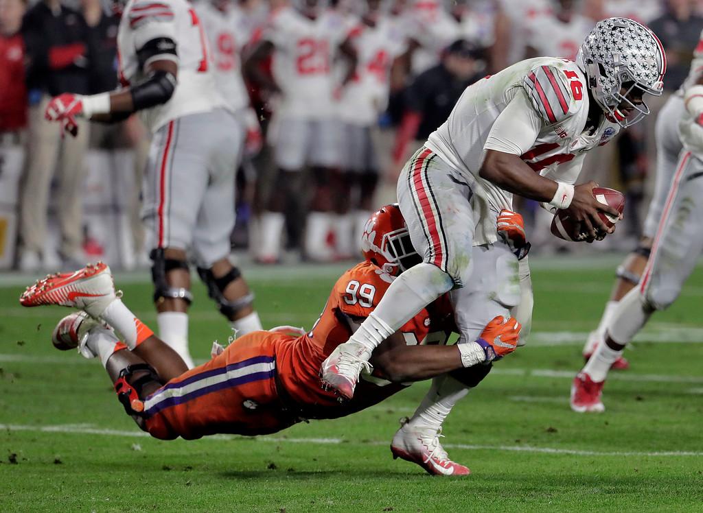 . Clemson defensive end Clelin Ferrell (99) sacks Ohio State quarterback J.T. Barrett (16) during the second half of the Fiesta Bowl NCAA college football playoff semifinal, Saturday, Dec. 31, 2016, in Glendale, Ariz. (AP Photo/Rick Scuteri)
