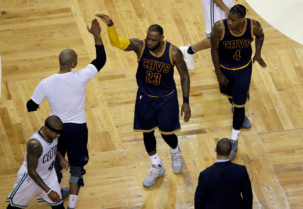 . Cleveland Cavaliers forward LeBron James (23) gets a high-five during a timeout in the second quarter of Game 1 of the NBA basketball Eastern Conference finals against the Boston Celtics, Wednesday, May 17, 2017, in Boston. (AP Photo/Charles Krupa)