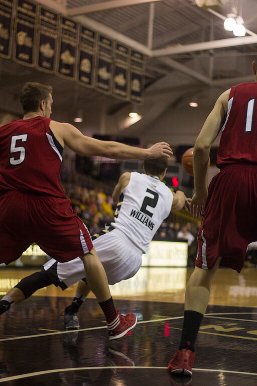 . Williams falls while attempting to pass the ball to Bader. Photo by Dylan Dulberg