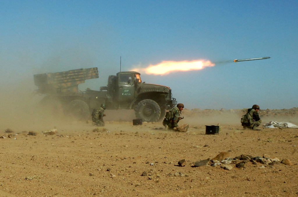 """. In this undated photo provided late Sunday Dec. 4, 2011 by the Syrian official news agency SANA, which they claim shows Syrian soldiers kneeling next to a multiple rocket launcher as they fire missiles during a maneuver at an unknown location, in Syria. Syrian President Bashar Assad\'s regime has a host of options if the United States launches military strikes against it. It could directly retaliate with rockets or unleash allies like Hezbollah against Western targets. Or it could do nothing -- and score propaganda points as a victim of \""""U.S. aggression.\"""" The regime\'s choice, analysts say, will likely depend on the magnitude of the U.S. military action -- the bigger and more sustained the strikes, the more likely the government in Damascus will feel compelled to respond. (AP Photo/SANA, File)"""