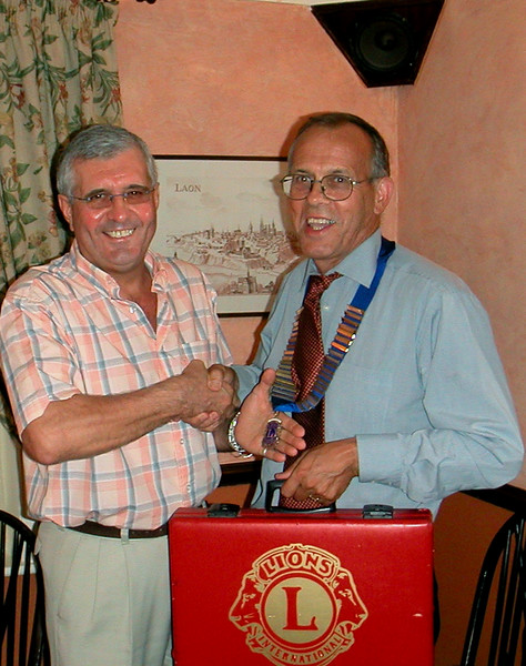 Outgoing president of the Isle of Axholme Lions, Alan Holgate left, hands over the chain of office  to new president John Smedley of Haxey, at a dinner held in the Epworth Tap.