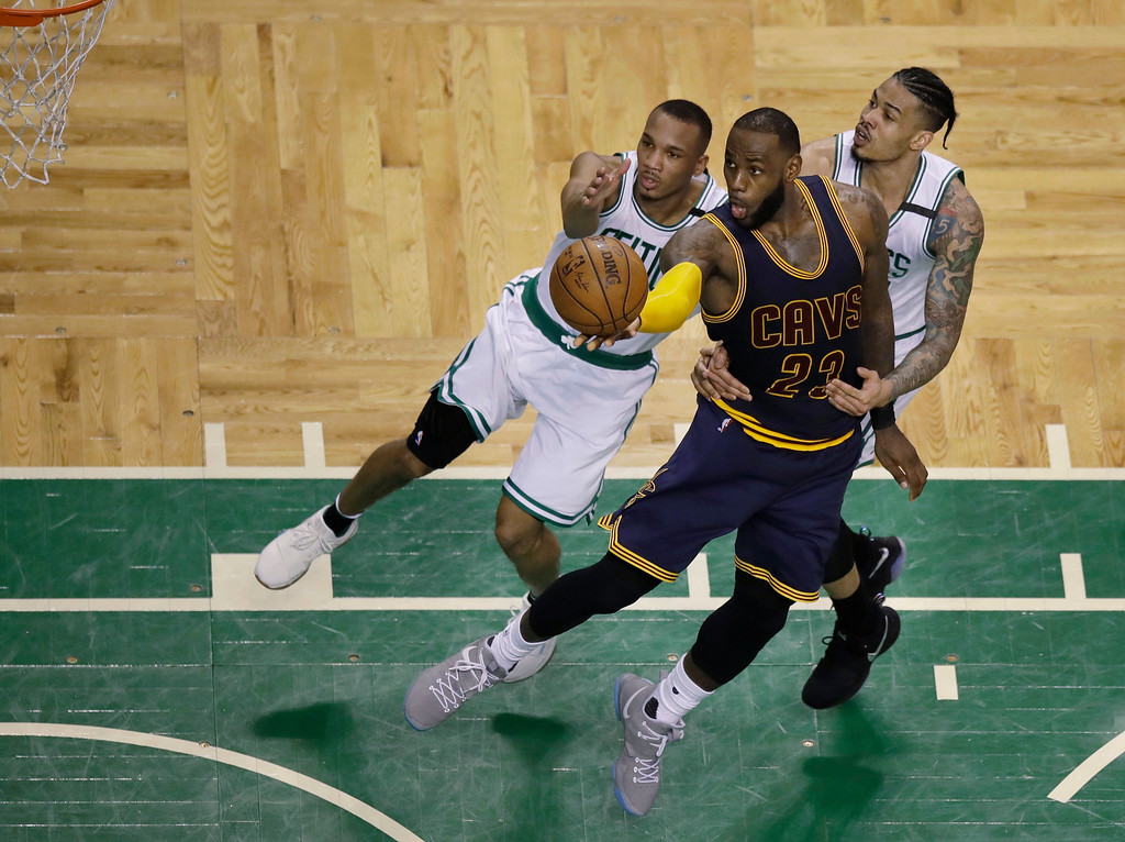 . Cleveland Cavaliers forward LeBron James (23) drives to the basket as Boston Celtics guard Avery Bradley, left, and forward Gerald Green, right, try to defend during the fourth quarter of Game 1 of the NBA basketball Eastern Conference finals, Wednesday, May 17, 2017, in Boston. (AP Photo/Charles Krupa)