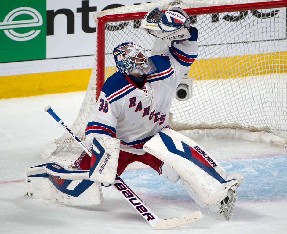 . New York Rangers goalie Henrik Lundqvist makes a glove save against the Montreal Canadiens during the second period in Game 1 of the Eastern Conference finals in the NHL hockey Stanley Cup playoffs against in Montreal on Saturday, May 17, 2014. (AP Photo/The Canadian Press, Adrian Wyld)