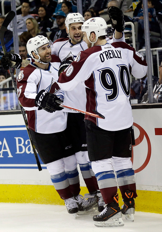 . Colorado Avalanche\'s Patrick Bordeleau, center, celebrates his goal with teammates Ryan O\'Reilly (90) and Maxime Talbot, left, during the second period of an NHL hockey game against the San Jose Sharks on Friday, April 11, 2014, in San Jose, Calif. (AP Photo/Marcio Jose Sanchez)