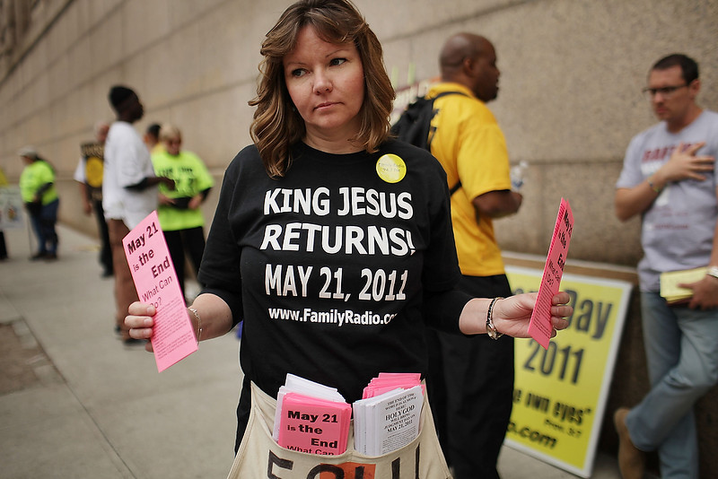 . Julie Baker walks the streets proselytizing with other believers that the world will end May 21, Judgment Day in New York City on May 13, 2011. The Christian based movement, which claims thousands of supporters around the country and world, was founded by the Oakland, Calif.-based Harold Camping. Camping is president of Family Stations Inc., a religious broadcasting network that promotes the belief that May 21, 2011 is Judgment Day. Camping claims to have come to this date by a deep and complex study of religious texts. Camping was wrong on his prior end-of-the-world prediction in 1994.  (Photo by Spencer Platt/Getty Images)