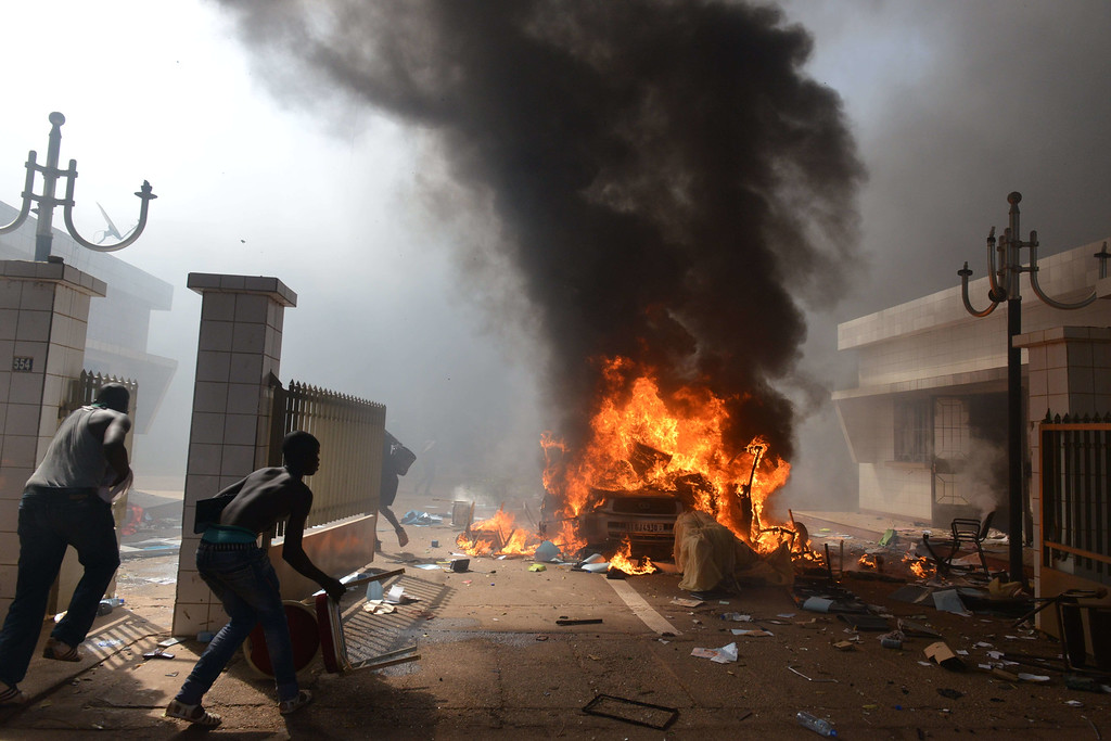 . Prostestors enter the parliament in Ouagadougou on October 30, 2014.ISSOUF SANOGO/AFP/Getty Images