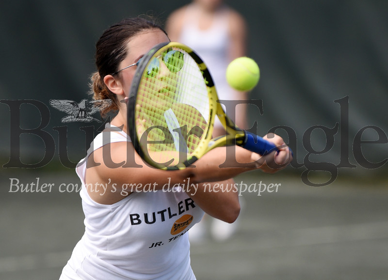 Harold Aughton/Butler Eagle: Maura Offstein of the Butler Country Club team, returns a serve during the 2019 West Penn Inter-club mixed doubles Junior Tennis Team Championships held Thursday, June 27 at the Butler Country Club.