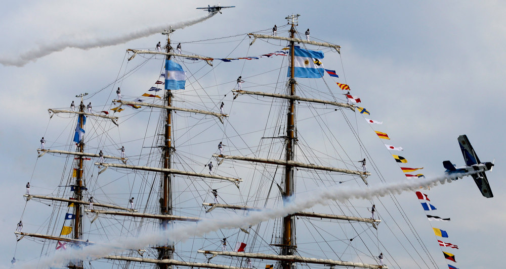 Description of . Sailors stand on the yardams of Argentina's naval training tall ship ARA Libertad as planes fly past during a welcoming ceremony at the port of Mar del Plata, Argentina, Wednesday, Jan. 9, 2013. The Argentine naval ship detained for more than two months in Ghana because of a financial dispute returned home to a triumphant welcome. Ghana courts ordered the ship held in October on a claim by Cayman Islands-based hedge fund NML Capital Ltd. But the U.N.'s International Tribunal for the Law of the Sea ordered the ship's release last month after Argentina argued that warships are immune from seizure. (AP Photo/Natacha Pisarenko)