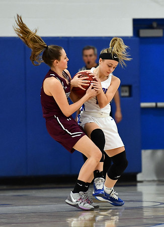 1/10/2020 Mike Orazzi | StaffrTorrington's Kate Mooney (22) and St. Paul's Kailyn Bielecki (2) at St. Paul in Bristol Friday night.