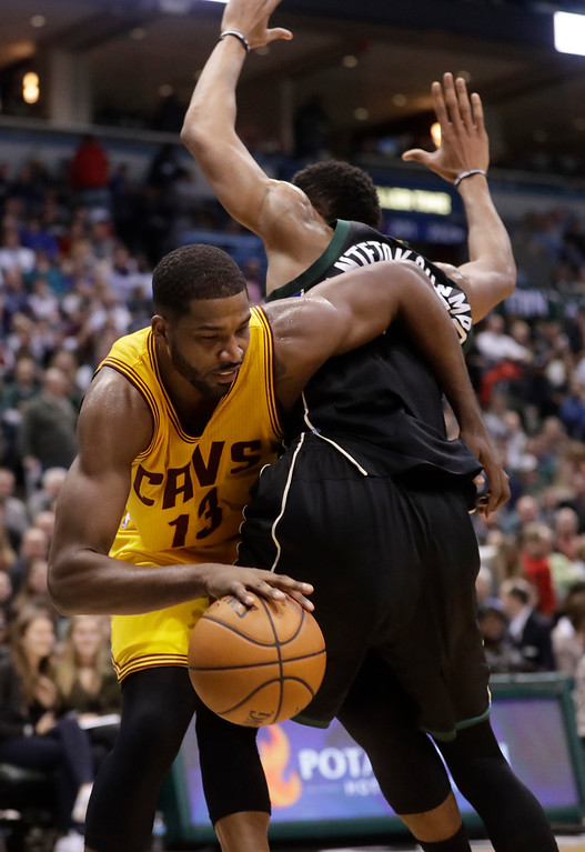 . Cleveland Cavaliers\' Tristan Thompson is called for a foul as he tries to drive past Milwaukee Bucks\' Giannis Antetokounmpo during the first half of an NBA basketball game Tuesday, Dec. 20, 2016, in Milwaukee. (AP Photo/Morry Gash)