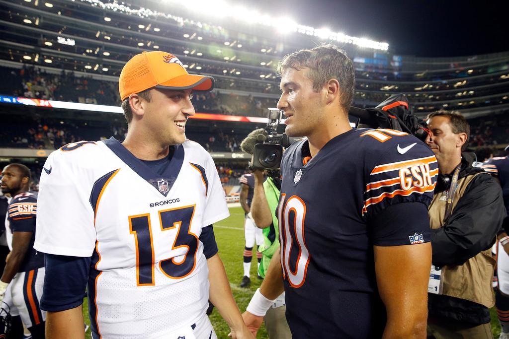 . Denver Broncos quarterback Trevor Siemian (13) talks to Chicago Bears quarterback Mitchell Trubisky (10) after an NFL preseason football game, Thursday, Aug. 10, 2017, in Chicago. The Broncos won 24-17. (AP Photo/Nam Y. Huh)