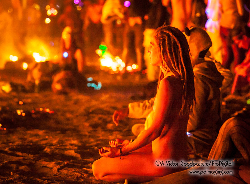 With the fire still burning, burners approach in costume and various stages of undress to celebrate and party —and in some cases meditate.