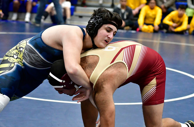 12/15/2018 Mike Orazzi | Staff New Britain's Josiah Vellen and East Haven's Tyler Kruse in a 195 match during the Plainville Invitational Wrestling Tournament Saturday.