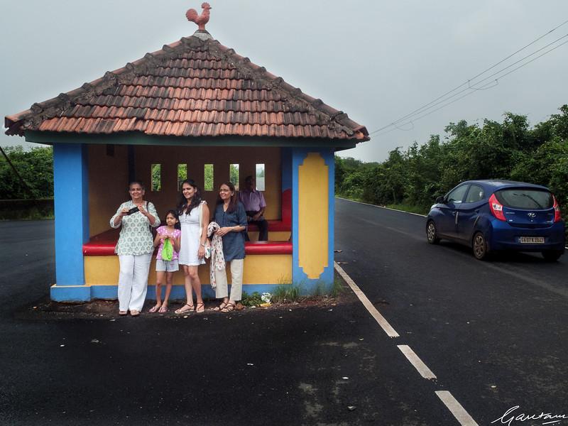 Family at bus stop, Divar