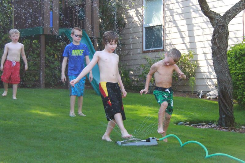 Sprinkler fun at Gavin's house.