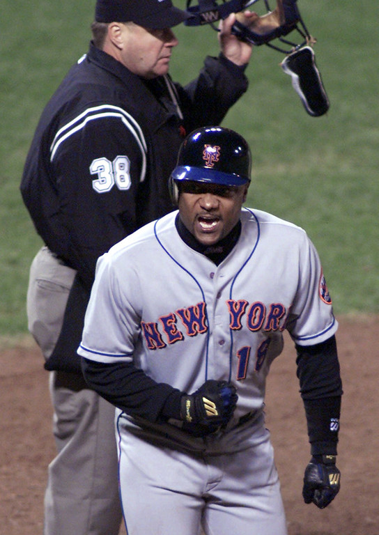 . In this Oct. 5, 2000, file photo, New York Mets\' Darryl Hamilton reacts after scoring the game-winning run in the 10th inning on a single by teammate Jay Payton in a baseball game against the San Francisco Giants in San Francisco. Authorities say Hamilton was killed Sunday, June 21, 2015, in a murder-suicide in the Houston suburb of Pearland, Texas. Pearland police say an initial investigation has determined Hamilton had been shot several times and that a woman in the home died of a self-inflicted gunshot wound. The woman was identified as Monica Jordan. (AP Photo/Eric Risberg, File)