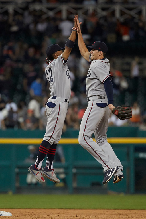 . Cleveland Indians shortstop Francisco Lindor, left, and center fielder Bradley Zimmer, right, celebrate after the second baseball game of a doubleheader against the Detroit Tigers in Detroit, Saturday, July 1, 2017. (AP Photo/Rick Osentoski)