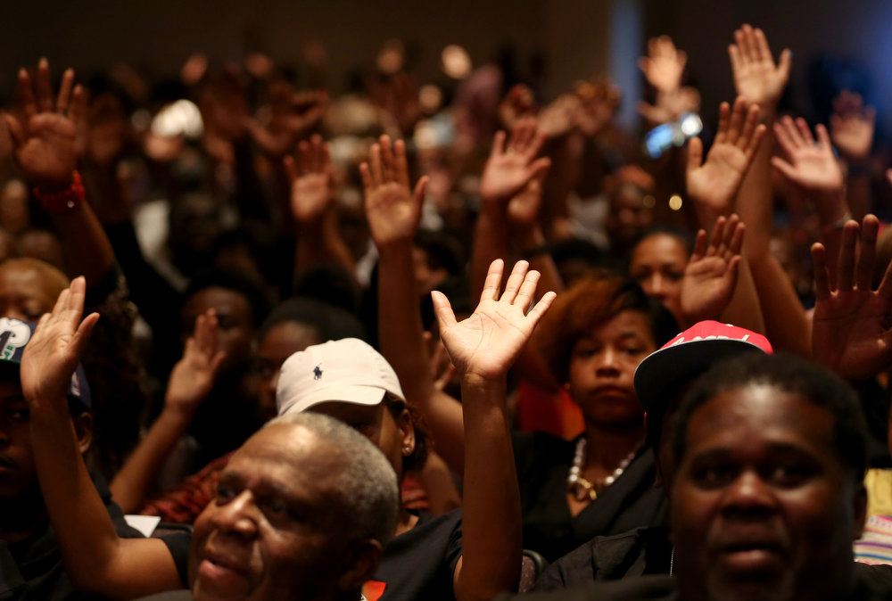 . People attend an event for slain 18-year-old Michael Brown at the Greater Grace Church on August 17, 2014 in Ferguson, Missouri. The event was lead by the Rev. Al Sharpton in support of justice for Michael Brown who was killed by police on August 9th.  (Photo by Joe Raedle/Getty Images)