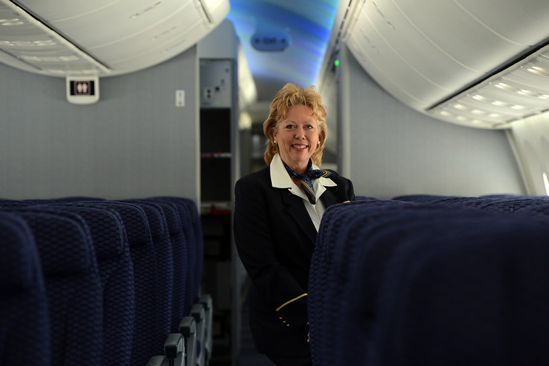 . United Airlines Flight Attendant Pam Pace poses for a portrait in the cabin of a 787 Dreamliner at Denver International Airport on Thursday, Nov. 29, 2012.  By March, the new jet is scheduled to begin flying between Denver International Airport and Japan\'s Narita International Airport. Craig F. Walker, The Denver Post