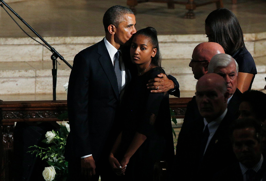 . President Barack Obama stands with his daughter Sasha and first lady Michelle Obama during funeral services for Vice President Joe Biden\'s son, Beau Biden, Saturday, June 6, 2015, at St. Anthony of Padua Church in Wilmington, Del. Obama delivered the eulogy for Vice President Joe Biden\'s son, Beau, who lost his battle with brain cancer at age 46. (Kevin Lamarque/Pool Photo via AP)