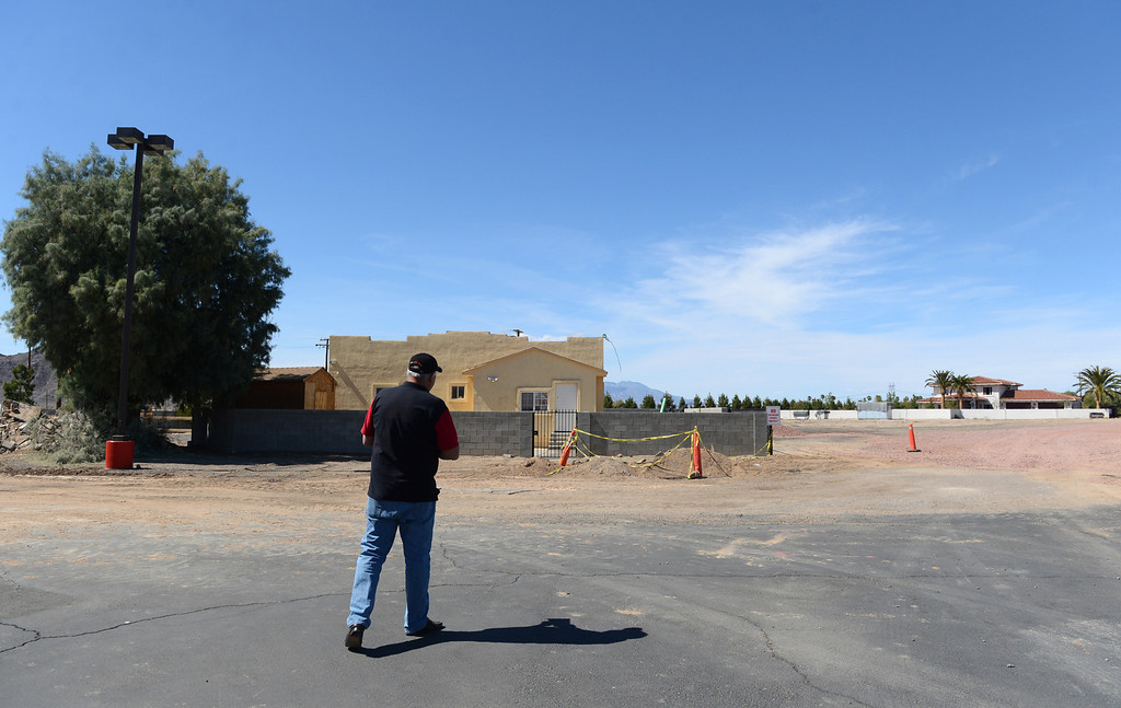. Businessman Luis Ramallo walks towards the area where the new development will be at Alien Fresh Jerky in Baker, CA, Thursday, April 3, 2014. Ramallo is planning to build a UFO shaped hotel behind the popular Alien Fresh Jerky store. (Photo by Jennifer Cappuccio Maher/Inland Valley Daily Bulletin)