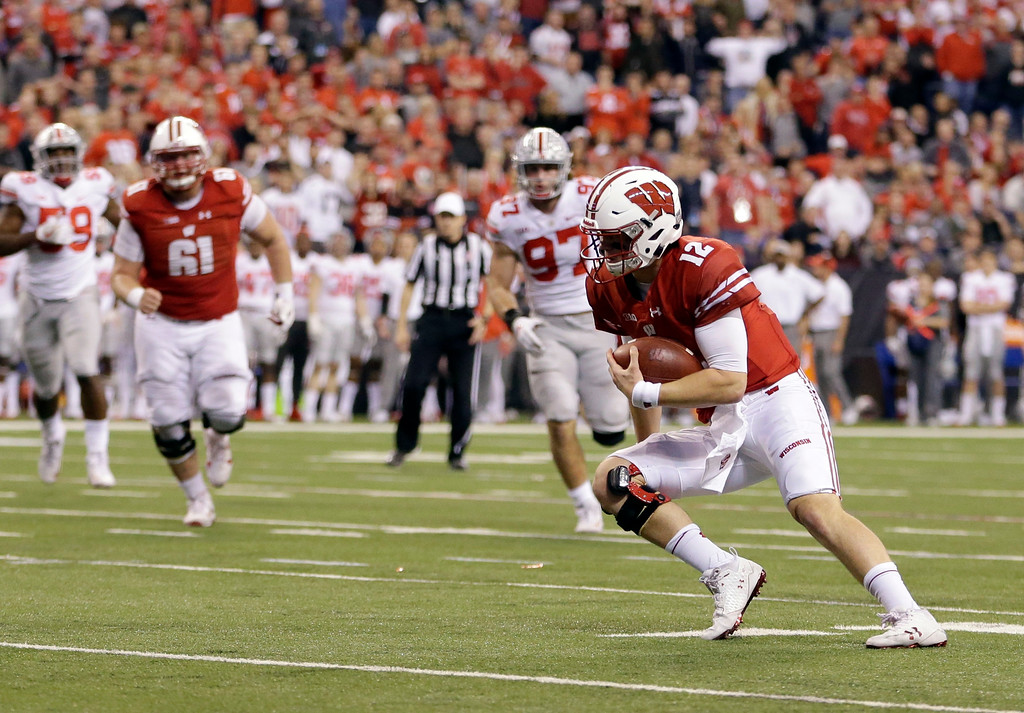 . Wisconsin quarterback Alex Hornibrook runs with the ball during the second half of the Big Ten championship NCAA college football game against Ohio State, Saturday, Dec. 2, 2017, in Indianapolis. (AP Photo/AJ Mast)