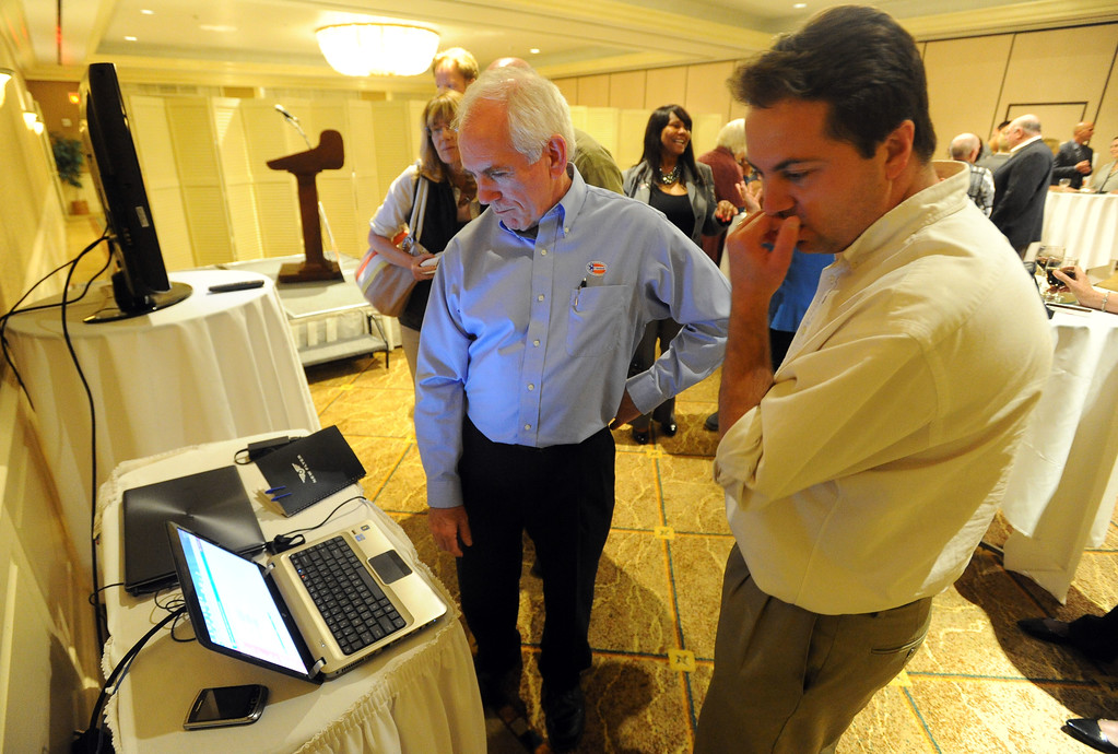 . Torrance mayoral candidate Tom Brewer, left, checks for updates in results at his election night party at the Doubletree Hotel in Torrance, CA on Tuesday, June 3, 2014. (Photo by Scott Varley, Daily Breeze)