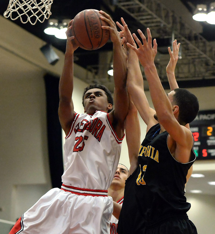 . Glendora\'s Peyton Terry (25) rebounds against California in the first half of a prep basketball game during the SoCal Shootout in the Felix Event Center on the west campus of Azusa Pacific University in Azusa, Calif., on Saturday, Jan. 18, 2014. (Keith Birmingham Pasadena Star-News)