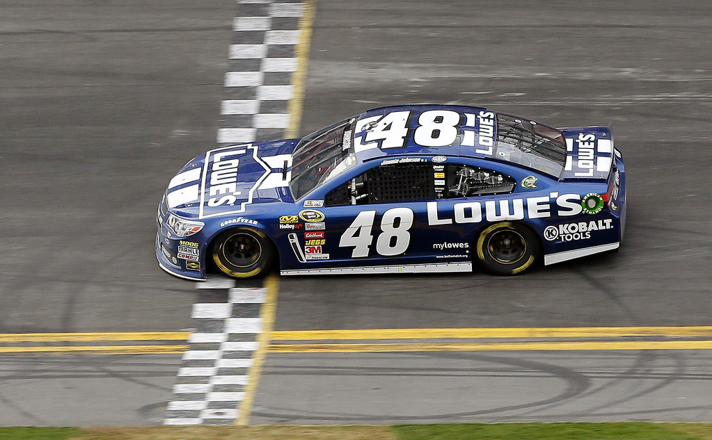 . Jimmie Johnson crosses the finish line to win the Daytona 500 NASCAR Sprint Cup Series auto race, Sunday, Feb. 24, 2013, at Daytona International Speedway in Daytona Beach, Fla. (AP Photo/Chris O\'Meara)