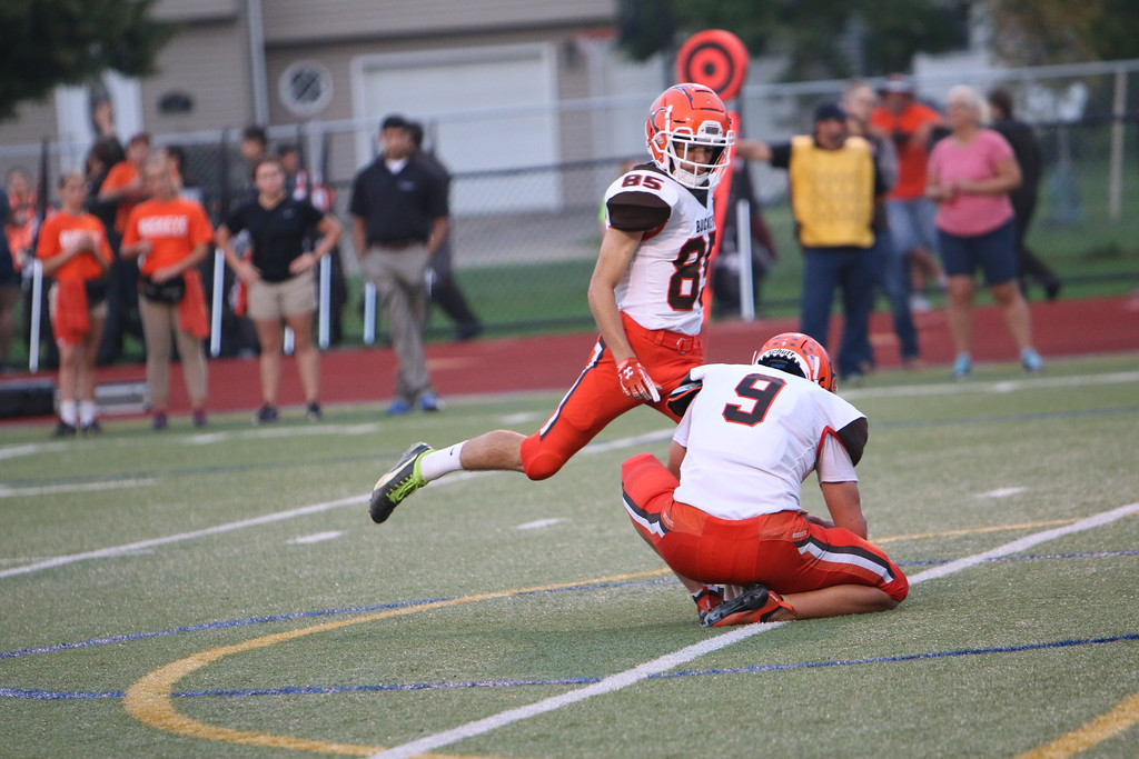 . Kyle Sooy - The Morning Journal<br> Buckeye\'s Clay Gunkelman takes a point after attempt against Lutheran West on Sept. 14.
