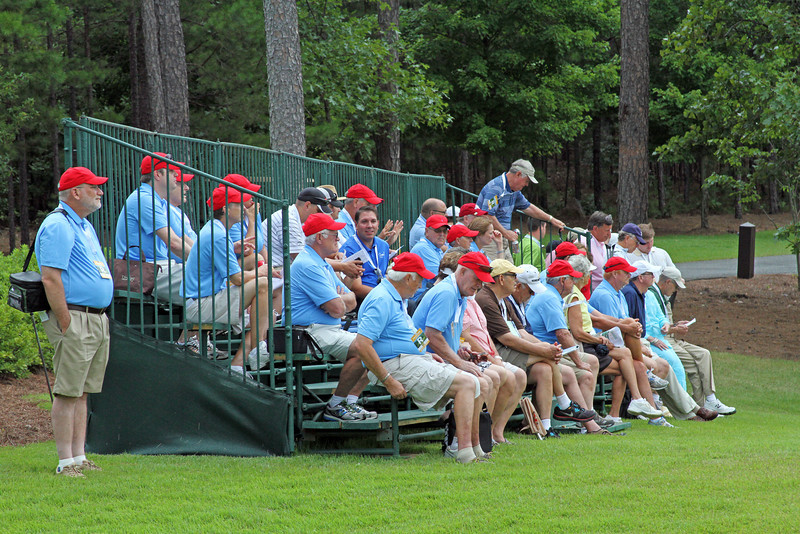 Volunteers and patrons gathered in the grandstand to the right of the 18th hole as the morning wave of players finished their opening rounds at the 111th Western Amateur at The Alotian Club in Roland, AR. (WGA Photo/Ian Yelton)