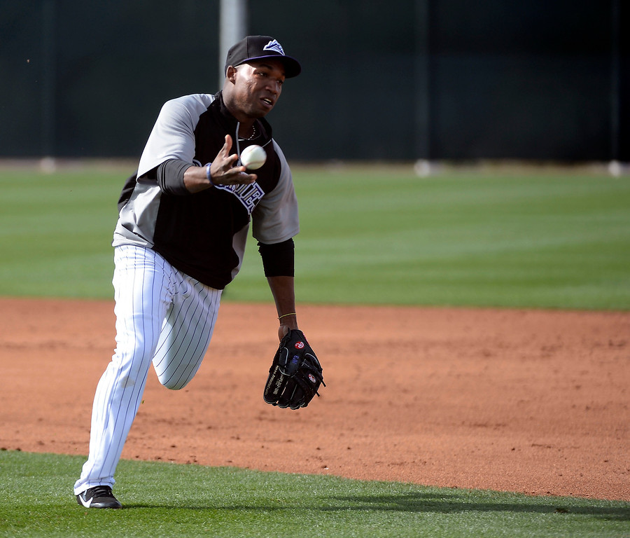 . SCOTTSDALE, AZ. - FEBRUARY 19: Colorado Rockies Jonathon Herrera (18) flips the ball to first during infield practices at  Spring Training February 19, 2013 in Scottsdale. (Photo By John Leyba/The Denver Post)