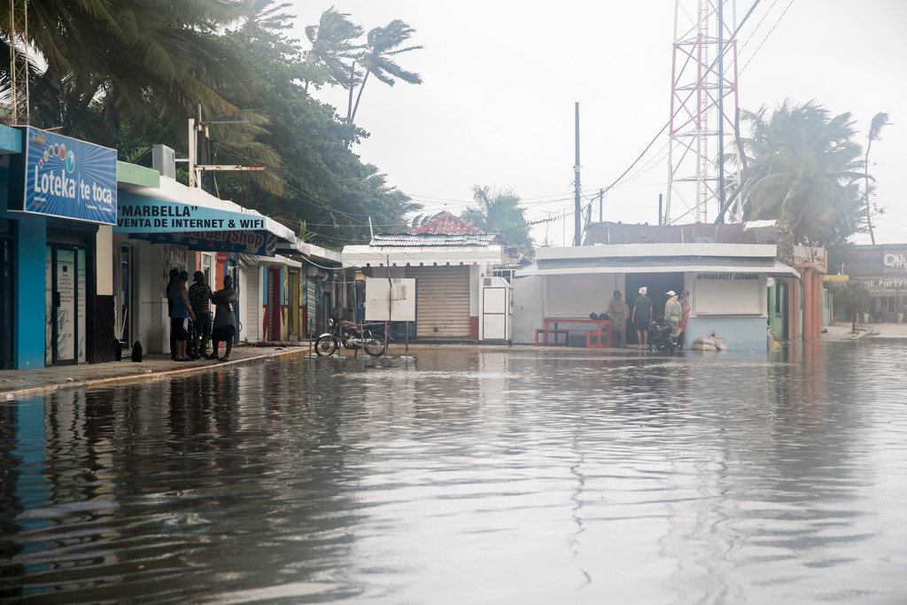 . Streets flood as Hurricane Maria approaches the coast of Bavaro, Dominican Republic, Wednesday, Sept. 20, 2017. The U.S. National Hurricane Center says Maria has lost its major hurricane status, after raking Puerto Rico. But forecasters say some strengthening is in the forecast and Maria could again become a major hurricane by Thursday. (AP Photo/Tatiana Fernandez)