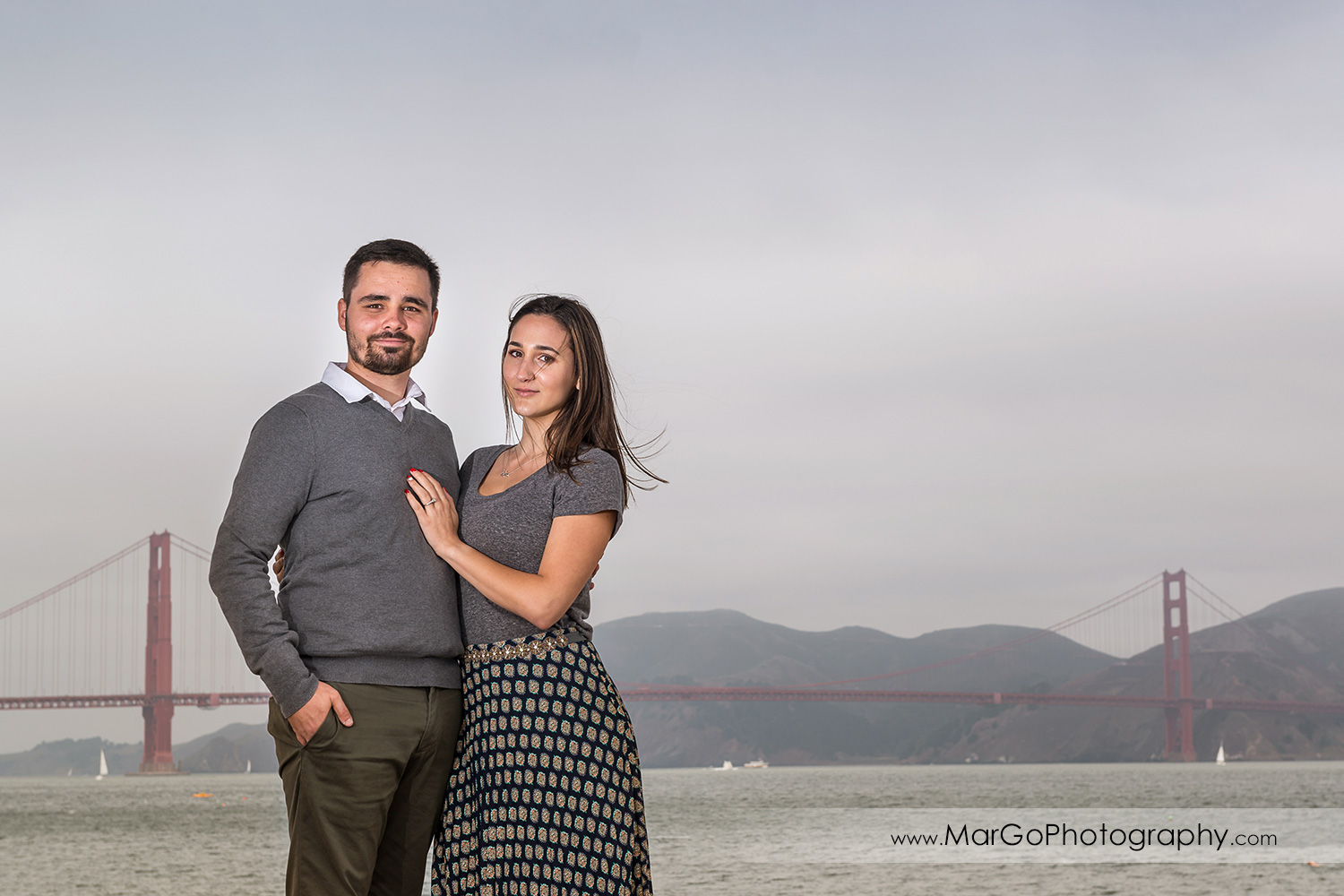 engagement session at Crissy Field in San Francisco - couple with Golden Gate in background