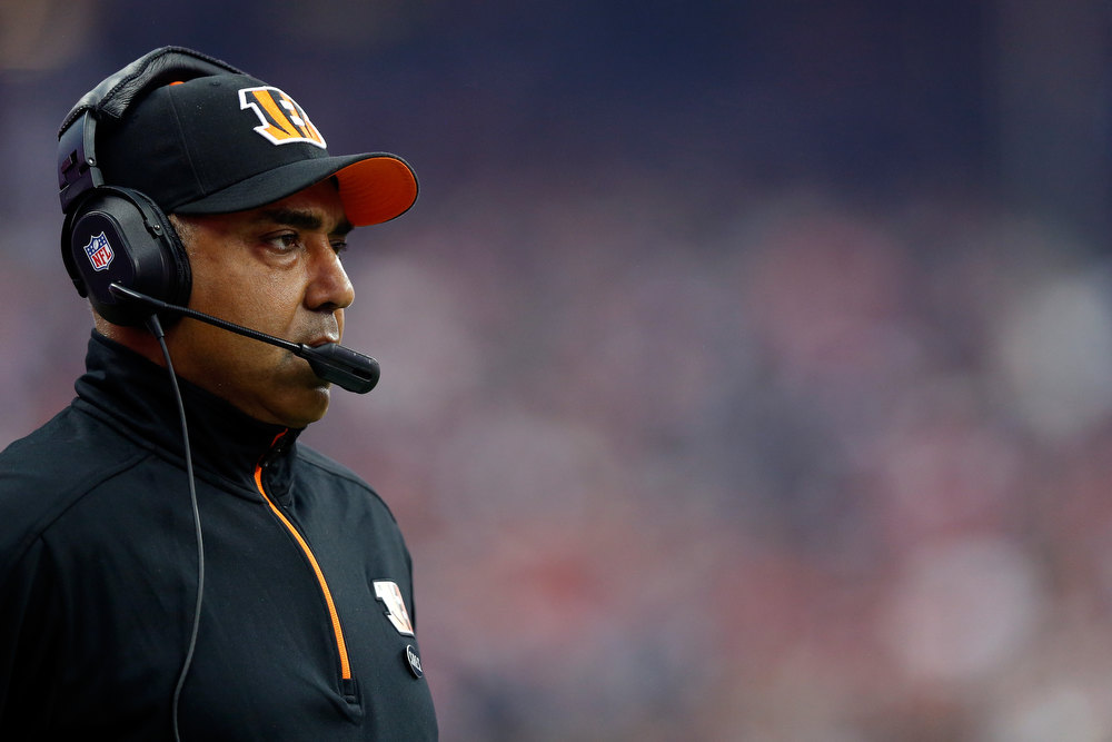 Description of . Head coach Marvin Lewis of the Cincinnati Bengals coaches against the Houston Texans during their AFC Wild Card Playoff Game at Reliant Stadium on January 5, 2013 in Houston, Texas.  (Photo by Scott Halleran/Getty Images)