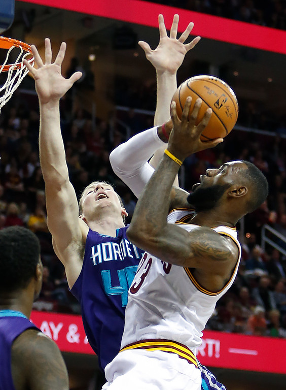 . Cleveland Cavaliers\' LeBron James (23) shoots against Charlotte Hornets\' Cody Zeller (40) during the first half of an NBA basketball game Sunday, Nov. 13, 2016, in Cleveland. (AP Photo/Ron Schwane)