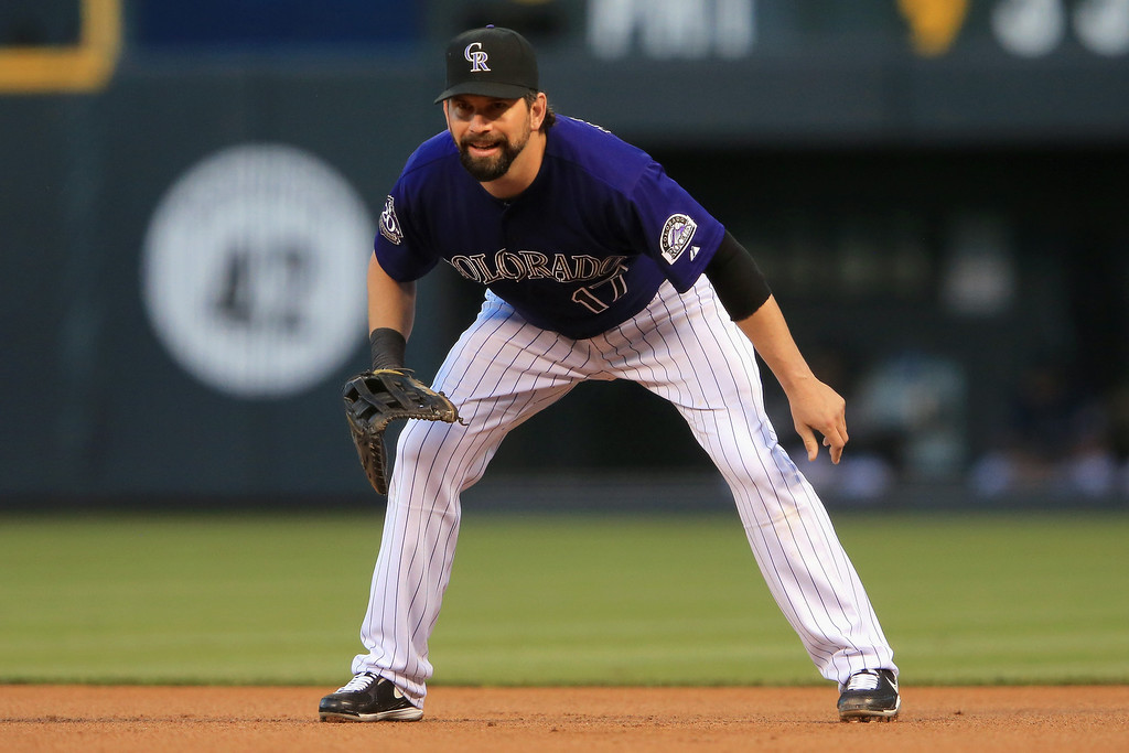 . First baseman Todd Helton #17 of the Colorado Rockies plays defense against the St. Louis Cardinals at Coors Field on September 16, 2013 in Denver, Colorado.  (Photo by Doug Pensinger/Getty Images)