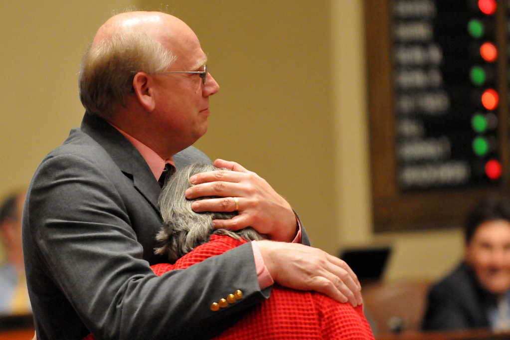 . Rep. Tim Faust, DFL-Hinckley, hugs Rep. Karen Clark as the votes on the House floor are tallied on Clark\'s bill allowing same-sex couples to wed. (Pioneer Press: John Doman)