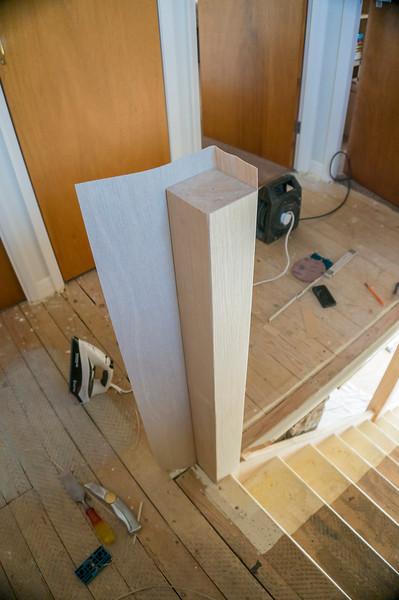 Veneering extended existing newels with Oak veneer to match handrails