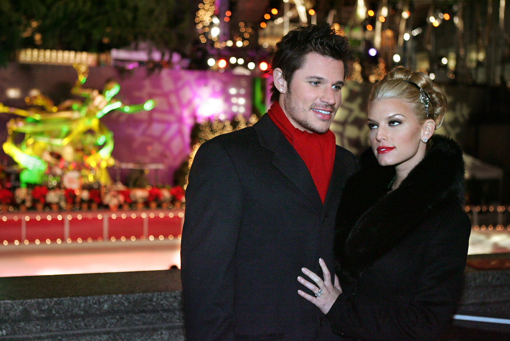 . Jessica Simpson, right, and Nick Lachey pose for photographs before the Rockefeller Center Christmas tree lighting ceremony Tuesday, Nov. 30, 2004 in New York. (AP Photo/Julie Jacobson)